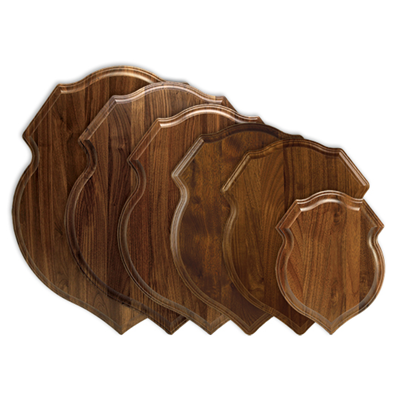 Solid walnut, crest-shaped plaque for taxidermy mounts.